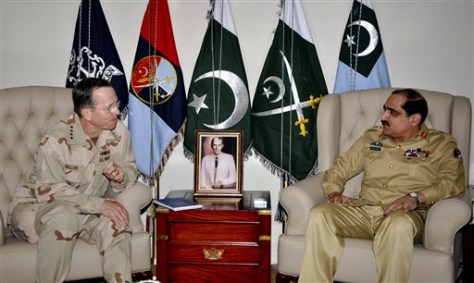 Image: U.S. Chairman of the Joint Chiefs of Staff Adm. Mike Mullen, left, listens to Pakistan's Chairman Joint Chiefs of Staff Committee General Khalid Shameem Wynne
