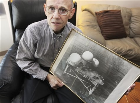 Image: Don Abbott holds a photo