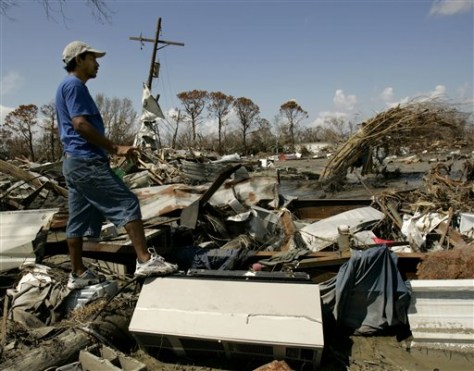 Image: Man surveys the remains of his home after Rita