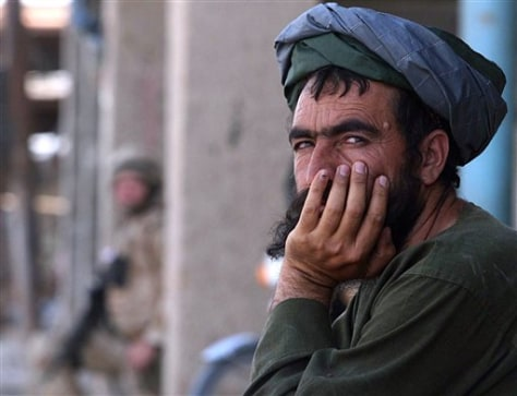 IMAGE: AFGHAN MAN AND BRITISH SOLDIER