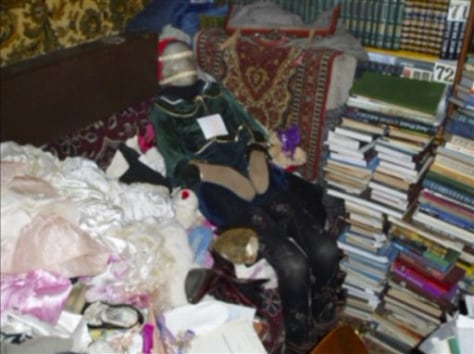 Image: Mummified body at home of Russian accused of robbing graves