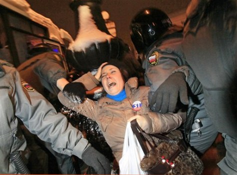 Image: POlice detain an opposition activist