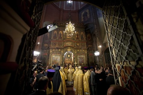 Image: Orthodox Church Patriarch Kirill, background, conducts a religious service