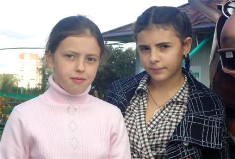 Image: 12-year-olds Anna, left, and Irina, right