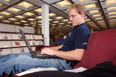 Student takes online class from on-campus library