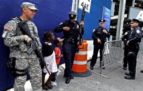 Image: A Port Authority police officer shares a light moment Saturday with children visiting from France at commuter train station near ground zero in New York.