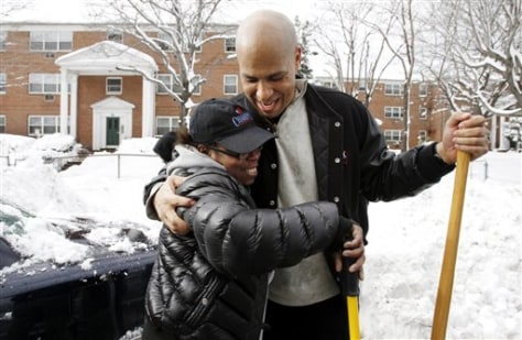 Image: Newark, N.J., Mayor Cory Booker gets a hug from Lakeesha Paylor
