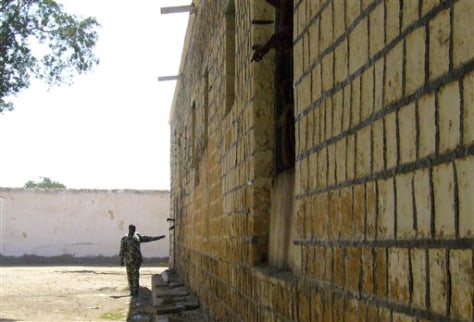 Image: A guard stands near a prison