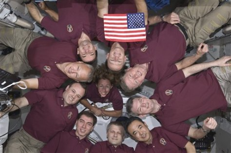 Image: Expedition 28 crew and Atlantis astronauts formed a microgravity circle for a portrait July 15, 2011.