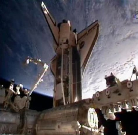 Image: Discovery after docking at space station