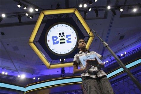 Image: Snigdha Nandipati, 13, from San Diego, Calif., spells out her word on her hand during round two of the National Spelling Bee