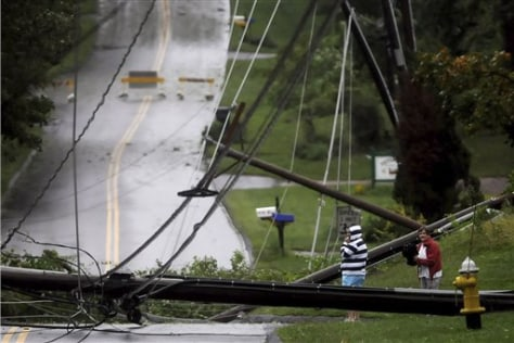 Image: Residents of South Windsor, Conn., look over wires and utility poles toppled by Tropical Storm Irene.