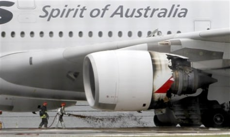 Image: Firefighters surround a Qantas plane