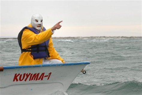 IMAGE: MEXICAN WRESTLER IN BOAT