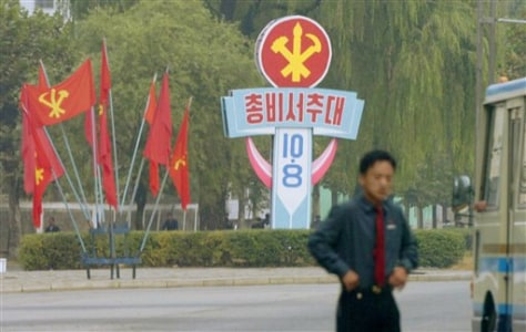 Image: North Korean Worker's Party flags and a billboard