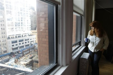 Image: Mary Perillo looks from her apartment