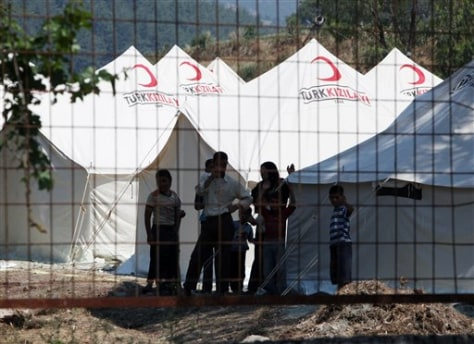 Image: Syrians take refuge in a camp set up by the Turkish Red Crescent in Turkish town of Yayladagi in Hatay province, Turkey.