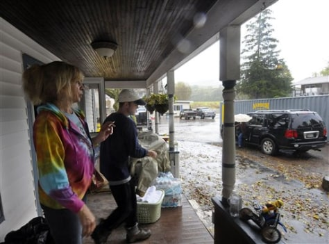 Image: Kathy Toranzo, left, and J.D. King prepare for a voluntary evacuation Wednesday after more rain and flooding are forecast in Prattsville, N.Y.