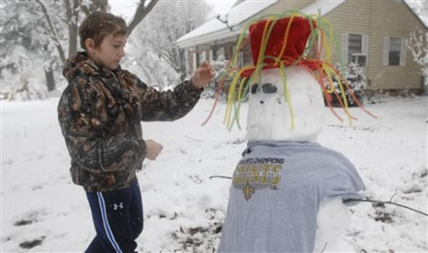 Image: Boy builds snowman in Crystal Springs, Miss.