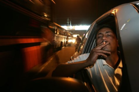 IMAGE: MAN SMOKING IN CAR