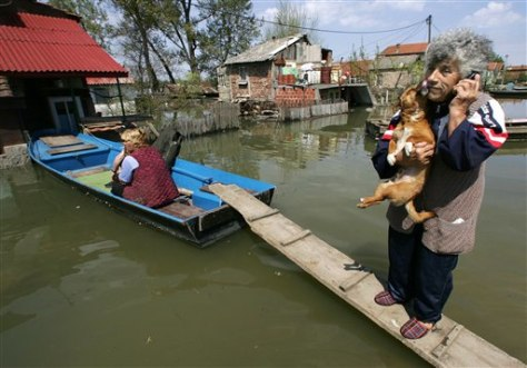 IMAGE: WOMAN AT FLOODED HOME