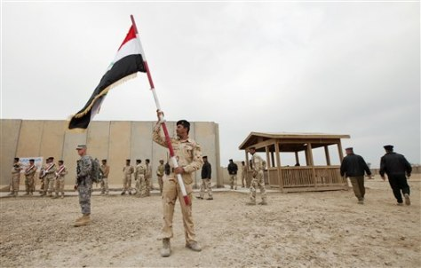 Image: A member of the Iraqi Army waves a flag