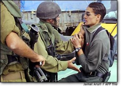 Image: Israeli soldier collars a Palestinian youth