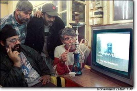 IMG: Lebanese men watching bin Laden tape