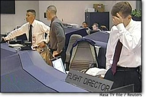 Image: Flight Director Leroy Cain Seen On February