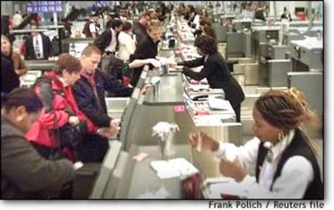 Image: Passengers Check In With Ticket Agents In Chicago