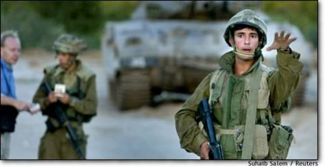 Image: Israeli Soldier Prevents Palestinian Workers From Returning Home Near Eraz Crossing Northern Gaza Strip