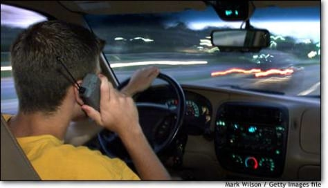 Image: Driver speaks on cell phone in Maryland