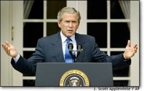 Image: President Bush responds to a reporter's question during a news conference in the Rose Garden at the White House.