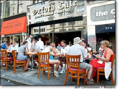 Image: People Sit Out On Sidewalk Cafe In New York City