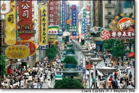 Image: Shoppers Crowd Under Huge Shop Signs Along Shanghai's Nanjing Road