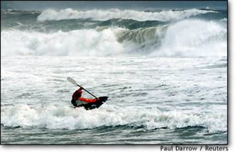 Image: A Kayaker Braves Large Waves As Hurricane Juan Approaches Halifax