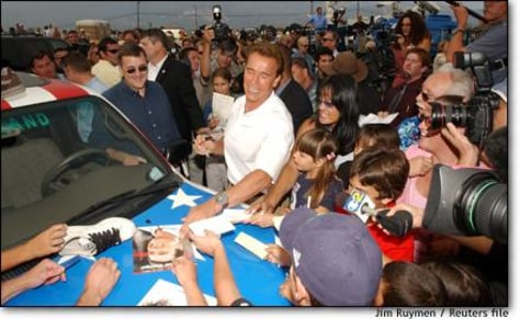 Image: Schwarzenegger stands next to hydrogen pickup truck