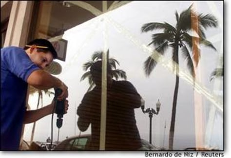 Image: Man Boards His Shop In Puerto Vallarta In Preparation For Hurricane Olaf