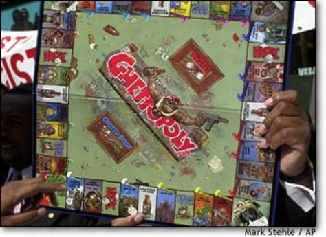 Not fabulous: A 'Ghettopoly' board game is held by a demonstrator during a
