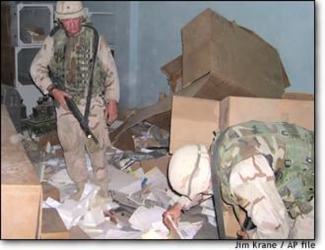 Image: Us Soldier Pore Through Documents