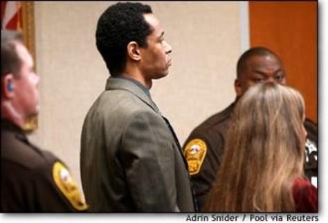 Image: Muhammad listens to verdict