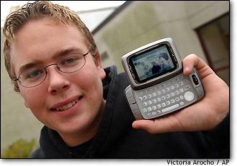 Image: Blaisdell holds T-Mobile Sidekick