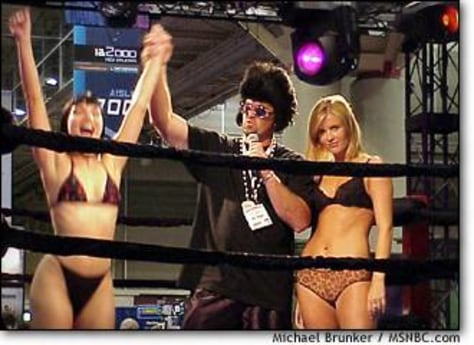 IMAGE: WOMAN WRESTLERS AT PORN CONVENTION