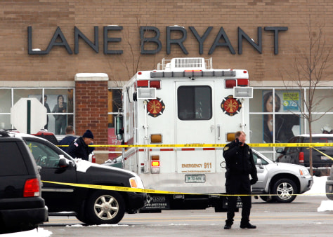 Image: Police investigate the shooting at a Lane Bryant store