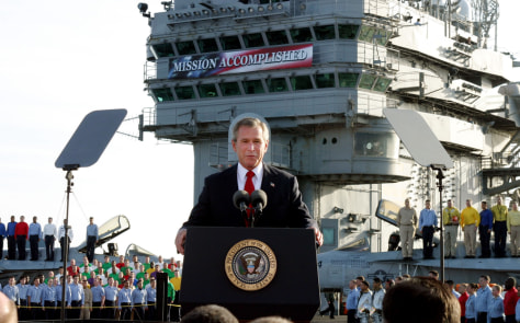 "Image: Bush with ""Mission Accomplished"" banner"