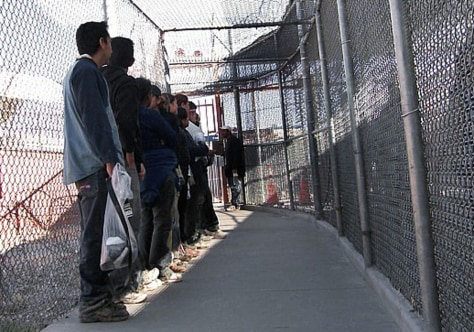 Image: Illegal immigrants from Mexico wait in a holding area in El Paso, Texas
