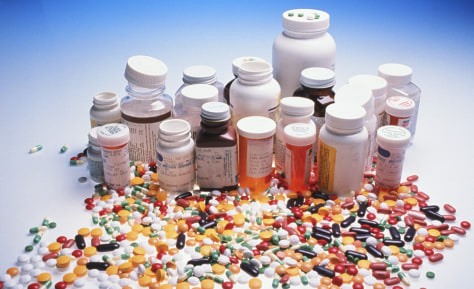 Image: Prescription pills and pill bottles