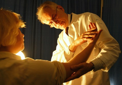 Image: A doctor checking for signs of skin cancer