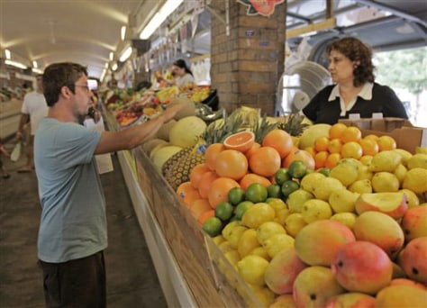 Image: A man shops for fruit at a stand at the West Side Market in Cleveland, Wednesday, July 16, 2008. Food prices showed a big increase in June, rising by 0.7 percent, more than double the 0.3 percent increase of May. Vegetable prices shot up by 6.1 percent, the biggest increase in nearly three years.