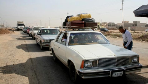 Image: Christians flee Mosul